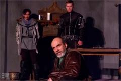 Geoffrey (Tyler Costigan) and Richard (Paul Nicklas) observe Henry (Mark Bilyk). Photo by RCS Maine